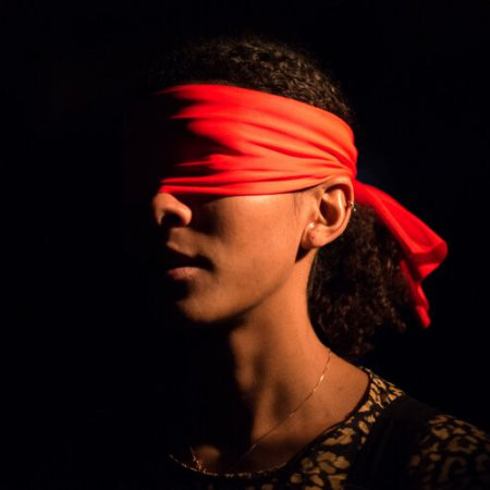 A person blindfolded in Tapestries by BitterSuite
